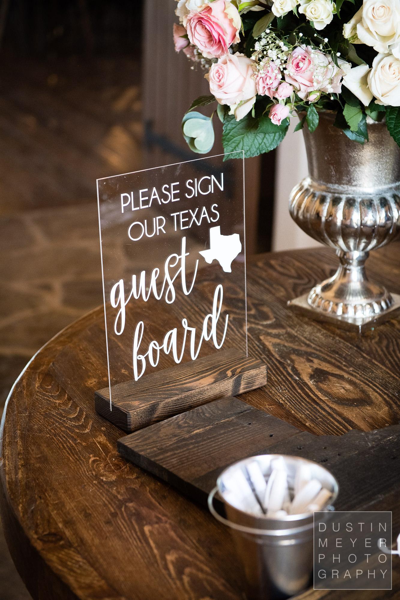 A custom sign-in clear sign for wedding guests