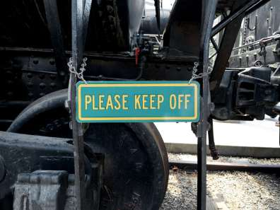 please keep off train sign