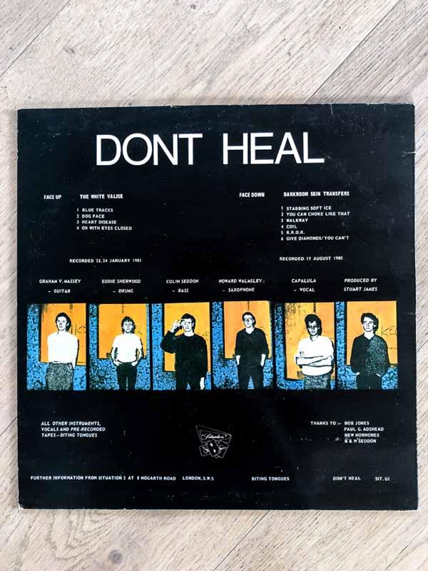 Biting Tongues vinyl sleeve of Don't Heal album back
