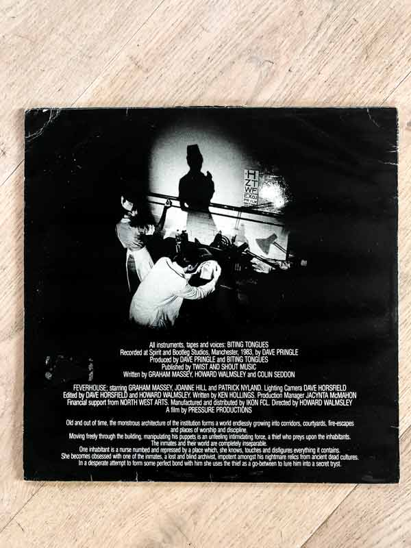 Biting Tongues vinyl sleeve of Feverhouse album back