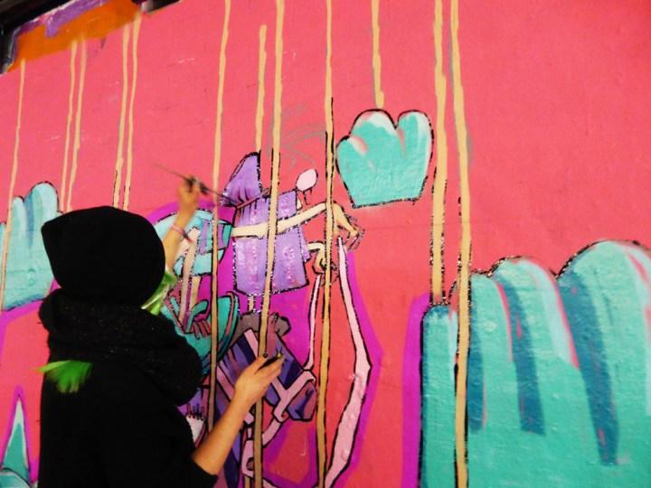 street artist Anna Rewinska at work in the Leake Street Tunnel