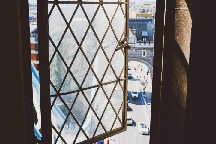 Inside Tower Bridge, London, looking out a window onto the road underneath