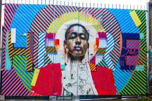 colourful collage-style mural by Conor Harrington and Maser in Shoreditch, London