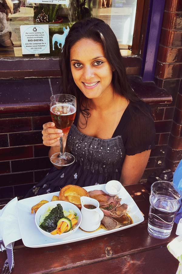 Dutch girl eating a Sunday roast in London