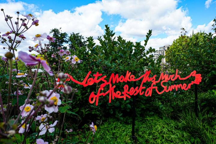 neon sign at Coal Drops Yard saying 'Let's make this much of the rest of summer'