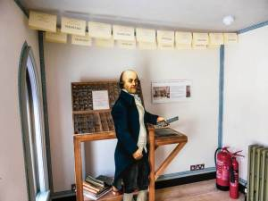 A cut-out model of Horace Walpole by letter press drawers