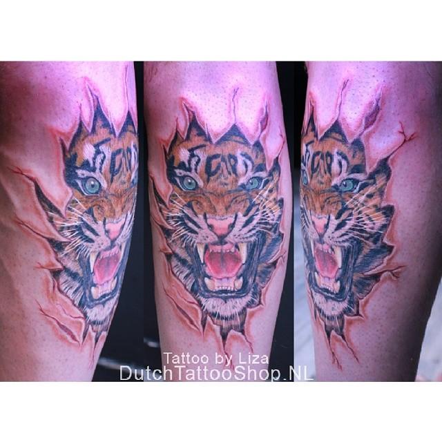 gescheurde-huid-tijger-ripped-skin-tiger-tattoo