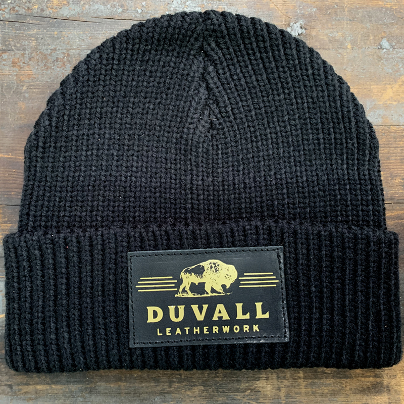 a warm kit cap with leather Duvall Leatherwork patch on front