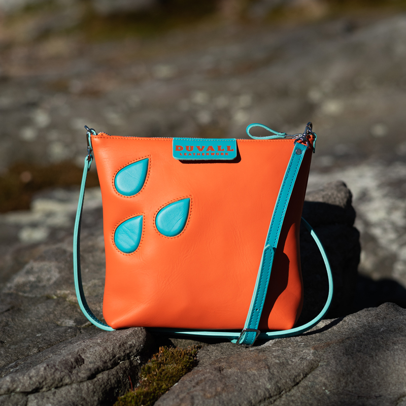 Tangarine colored leather crossbody bag