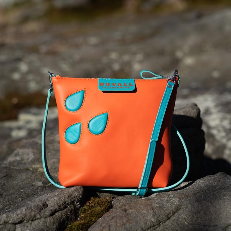 Tangarine colored leather crossbody bag