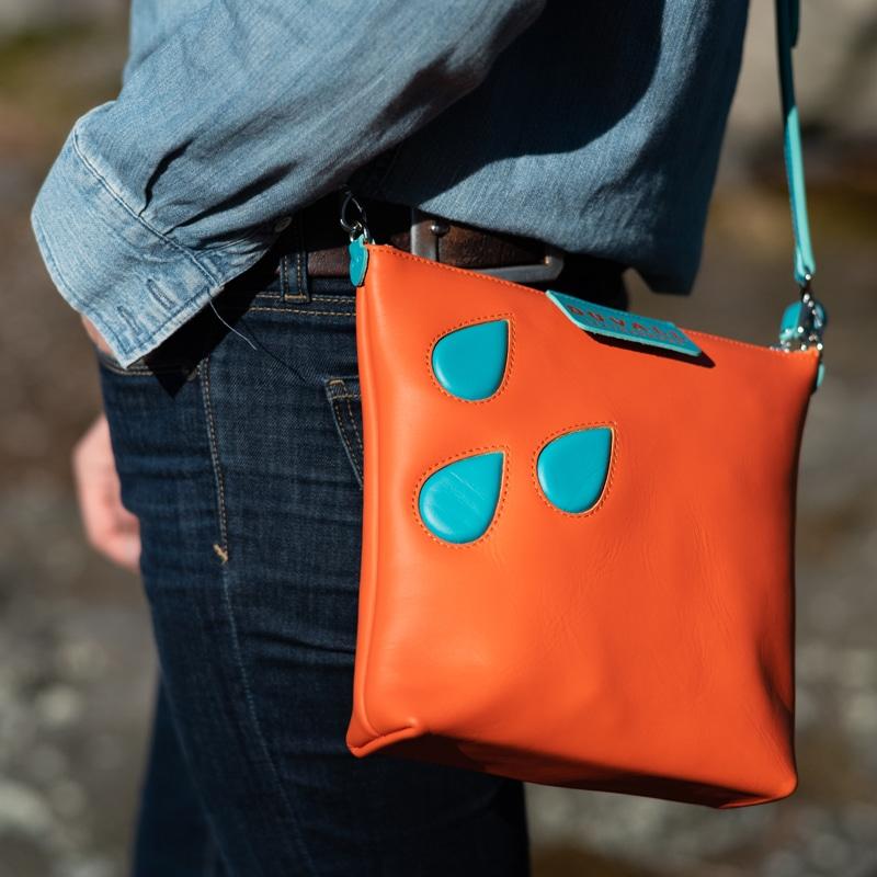 Orange crossbody bag from Duvall Leatherwork