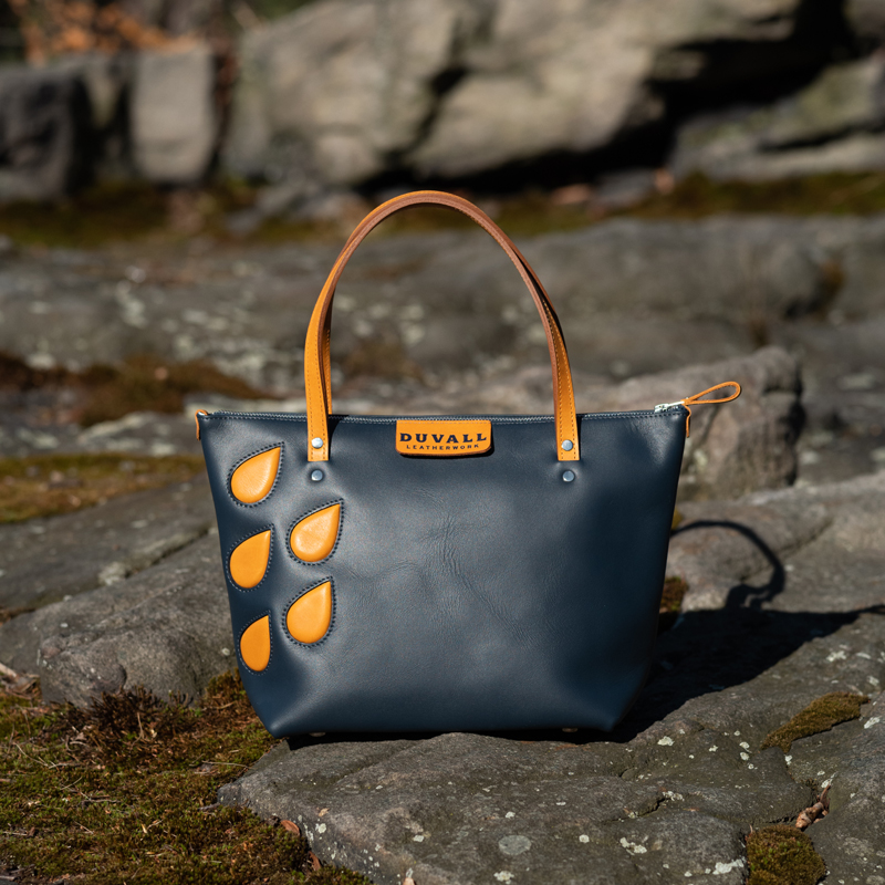 True blue handbag with saffron leather acsents