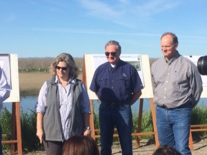 DU Western Region Director of Conservation Programs, Jim Well (center), spoke to the gathered media on the partnership between rice farmers and waterfowl.