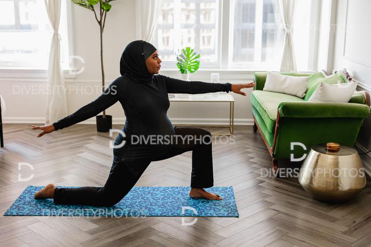Yoga has many benefits, including stress relief and improved flexibility. Black Muslim Woman Does Yoga At Home Wearing A Sport Hijab Diversity Photos Premium Stock Photos