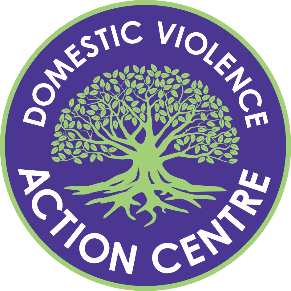 Domestic Violence Action Centre in white words on a purple background around a Moreton Bay Fig tree.