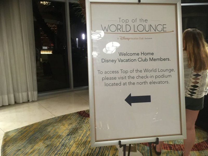 Signage with directions to Top of the World Lounge