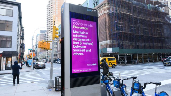 A LinkNYC screen in Gramercy is seen with information related to COVID-19 as the coronavirus continues to spread across the United States on March 20, 2020 in New York City. The World Health Organization declared coronavirus (COVID-19) a global pandemic on March 11th. (Photo by Noam Galai/Getty Images)