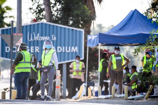 LOS ANGELES, CA - JANUARY 15: CORE employees are on hand to direct traffic at Dodger Stadium in Los Angeles after it was turned into a COVID-19 drive-thru vaccination site on Friday, January 15, 2021.