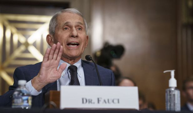 """Anthony Fauci, director of the National Institute of Allergy and Infectious Diseases, speaks during a Senate Health, Education, Labor, and Pensions Committee confirmation hearing in Washington, D.C., U.S., on Tuesday, July 20, 2021. The top U.S. infectious-disease expertyesterday said the delta variant of the coronavirus is causing a significant increase in infections and the Biden administration is """"practically pleading"""" with people to get vaccinated. Photographer: J. Scott Applewhite/AP Photo/Bloomberg"""