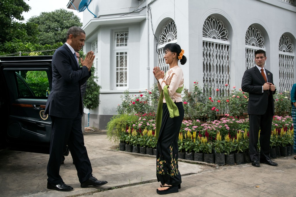 President Barack Obama greets Burmese Opposition Leader Aung San Suu Kyi during a visit to her private residence in Rangoon, Burma, Nov. 19, 2012. (Official White House Photo by Pete Souza) This official White House photograph is being made available only for publication by news organizations and/or for personal use printing by the subject(s) of the photograph. The photograph may not be manipulated in any way and may not be used in commercial or political materials, advertisements, emails, products, promotions that in any way suggests approval or endorsement of the President, the First Family, or the White House.Ê