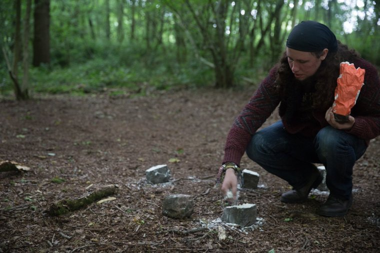 Matt Smith covers bricks in flour in Leicestershire woods