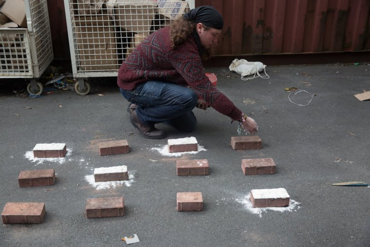 Array of bricks being covered in flour by Matt Smith