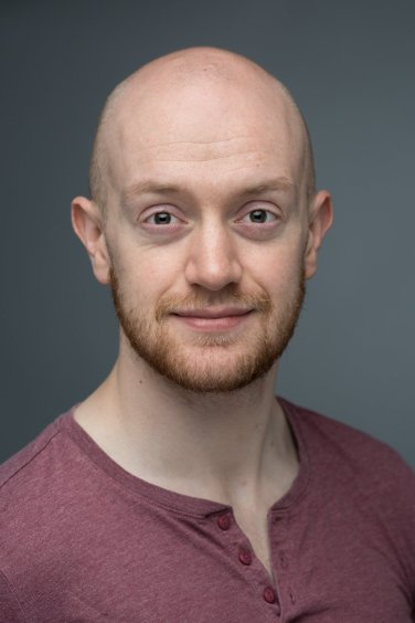 Headshot of actor Jonny McClean in Leicester studio