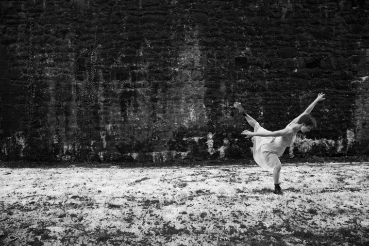 Black & White photo of Aimee Lily Williamson dancing in the snow