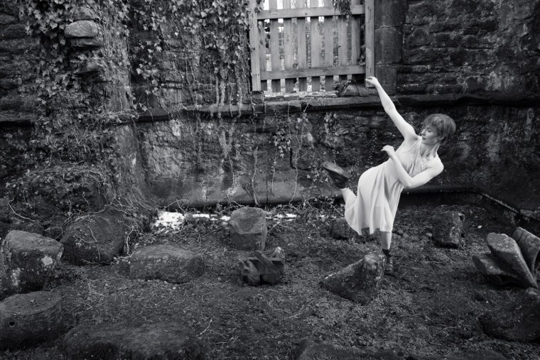 Black & White photo of Aimee Lily Williamson dancing in the Abbey ruins