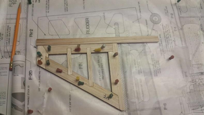 Fin framework glued and pinned