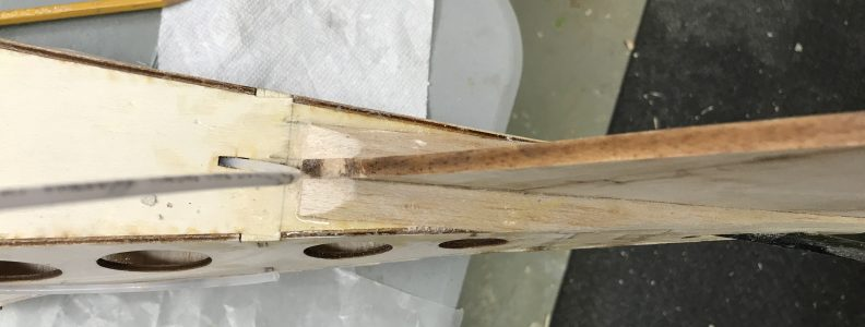 Bottom triangle stock sanded and formed at bottom of fin for aerodynamics
