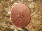 The Medallion Mari Magdalene had in her possession. You can see it expresses several basic dynamics, including the :Blossom and Stem uplifting the Tetra Sun emblem of Creation. It is also a form of the Blossom and Stem within the X-Cross of the Areiopax.