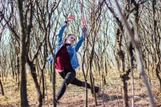 Dancer poses surrounded by trees