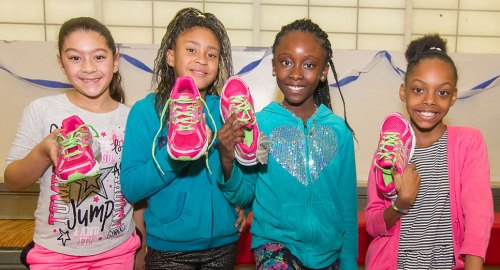 Kids from NYRR's Youth Programs and their new running shoes