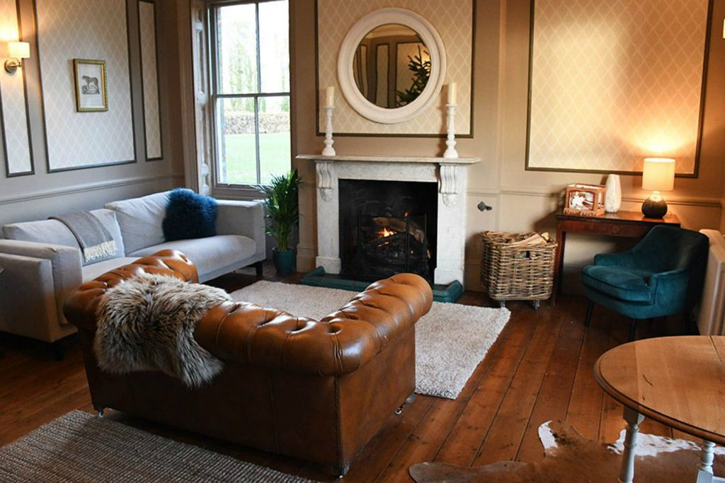 cosy living room with log burner table lamps for abbots court house sawday s