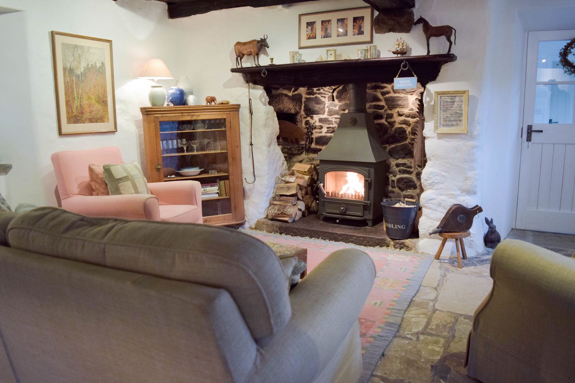 cosy living room with log burner how to arrange furniture around tv stares nest cottage self catering in devon sawday s sitting at