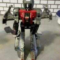 Sludge - Generation 1 Transformers Dinobots G1 -1984 Japanese ID number: 27 Foreign names Japanese- Sludge (スラージ Surāji), French- Slug, Terro (Canada), Italian- Bronto, Portuguese: Chafurda (Brazil)or Lama (Portugal)