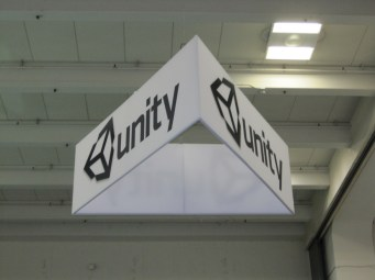 A triangular sign was hung above the booth to ensure attendees could find it from anywhere in the expo floor