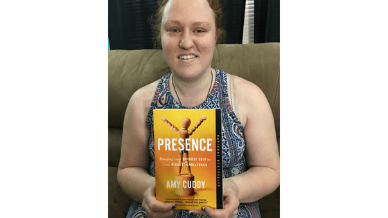 """Katie Corbett holds the book """"Presence"""" by Amy Cuddy"""