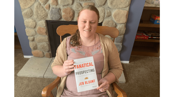 """Katie Corbett holds the book """"Fanatical Prospecting"""""""