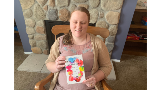 """Katie Corbett holds the book """"The Art of Gathering"""""""