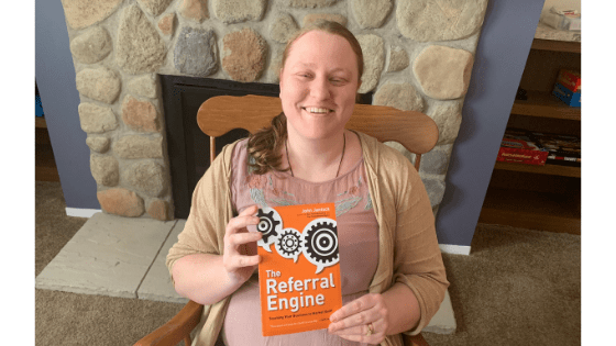"""Katie Corbett holds the book """"The Referral Engine"""""""