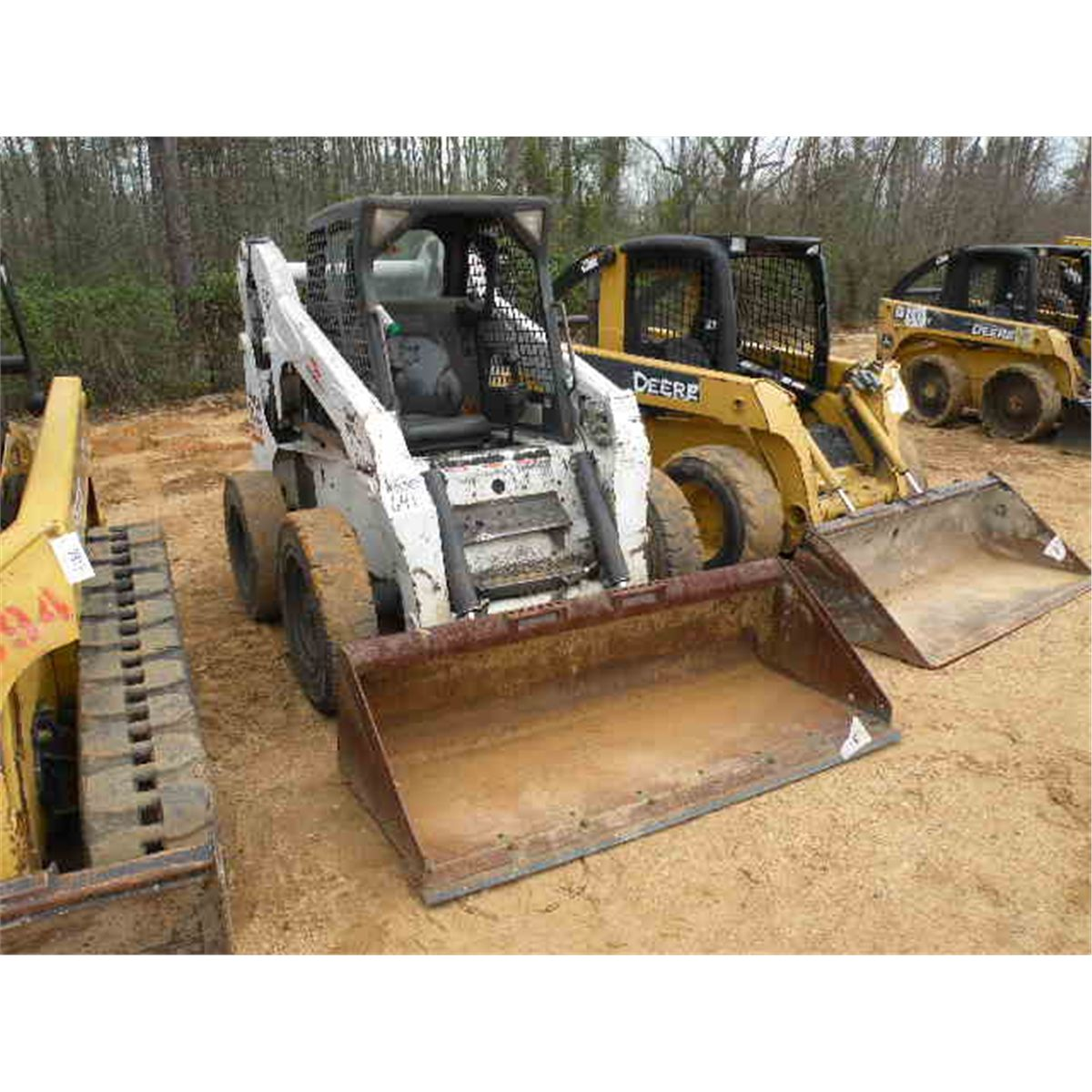 medium resolution of bobcat s250 skid steer loader loading zoom