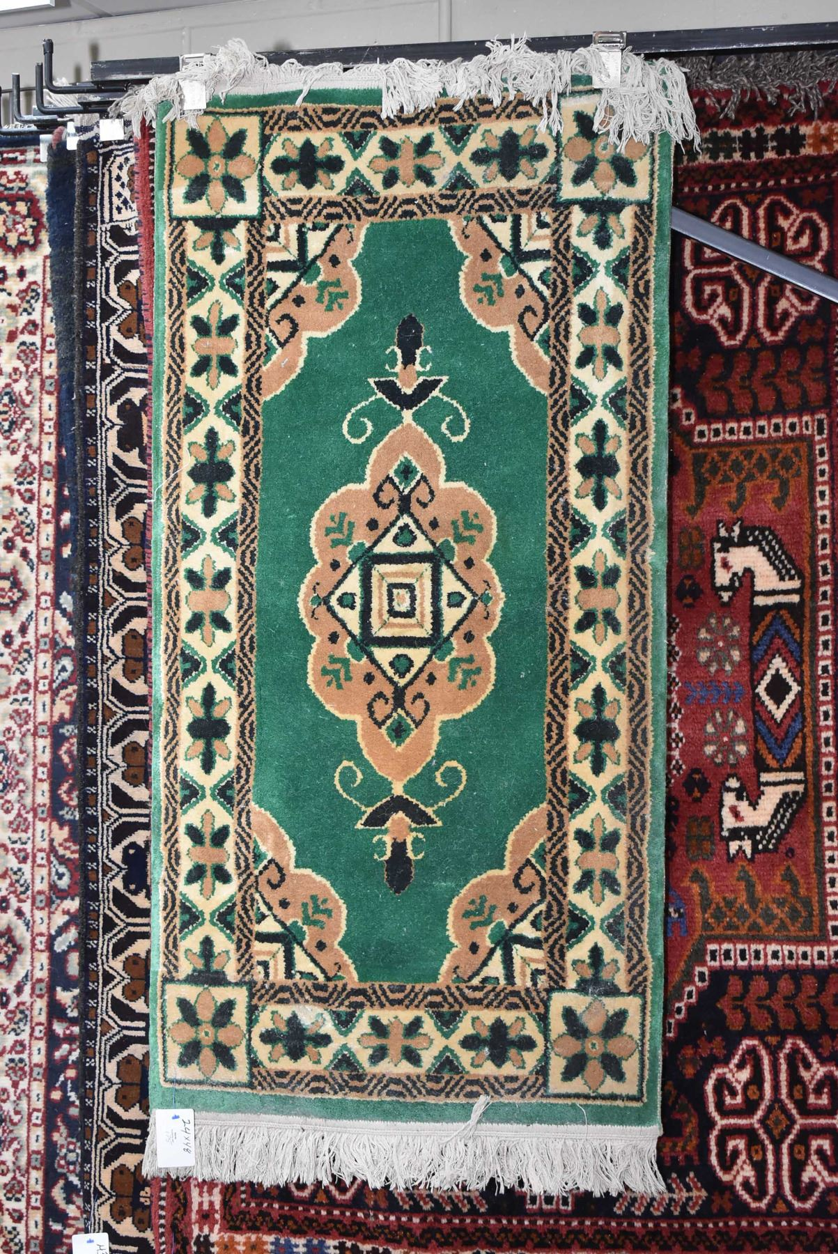 Small Wool Scatter Rug With Emerald Green Back And Center Medallion With Taupe And Black Highlights