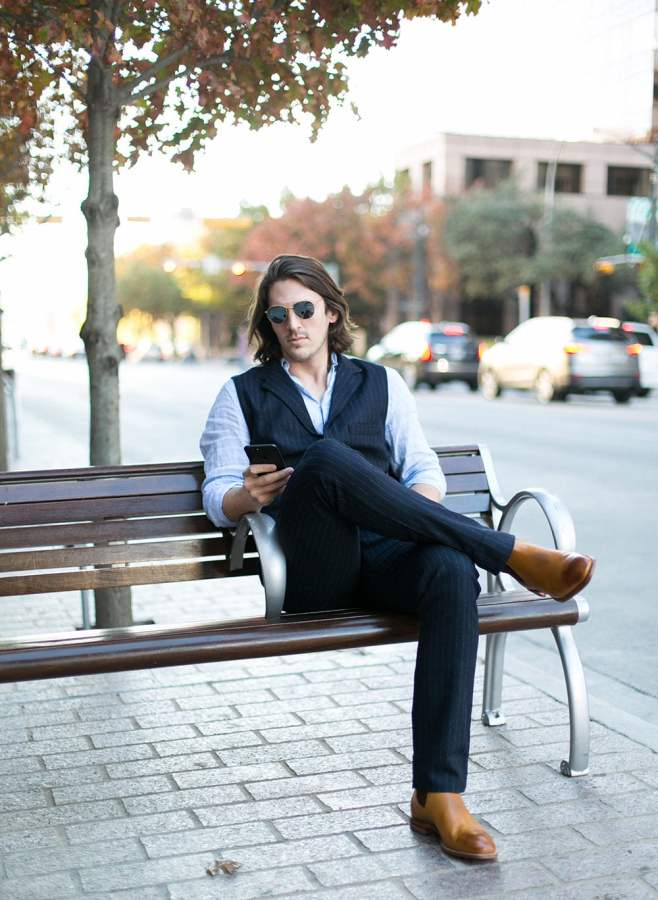 Sitting in Nifty Genius Navy Striped Vest and Pants with Linen Shirt and R. M. Williams Burnished Toe Chelsea Boots