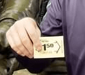 person holding a card saying 1:50