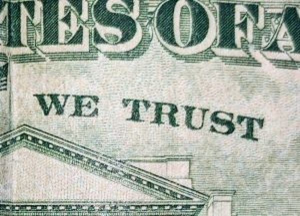 "closeup of ""we trust"" on a $20 bill"