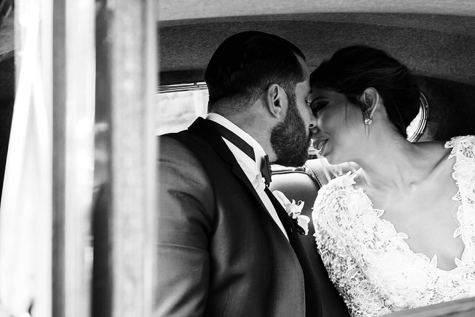 Before heading to the reception the bride and groom kiss in the back of their wedding car. | London Ontario Wedding Photographer - Photo taken in Sydney, Australia by Dylan Martin Photography
