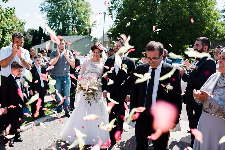 Bride and groom celebrating with flower petals being thrown in traditional Lebanese - Woodstock London Ontario Lebanese middle eastern arab Wedding and engagement photos - Dylan Martin Photography