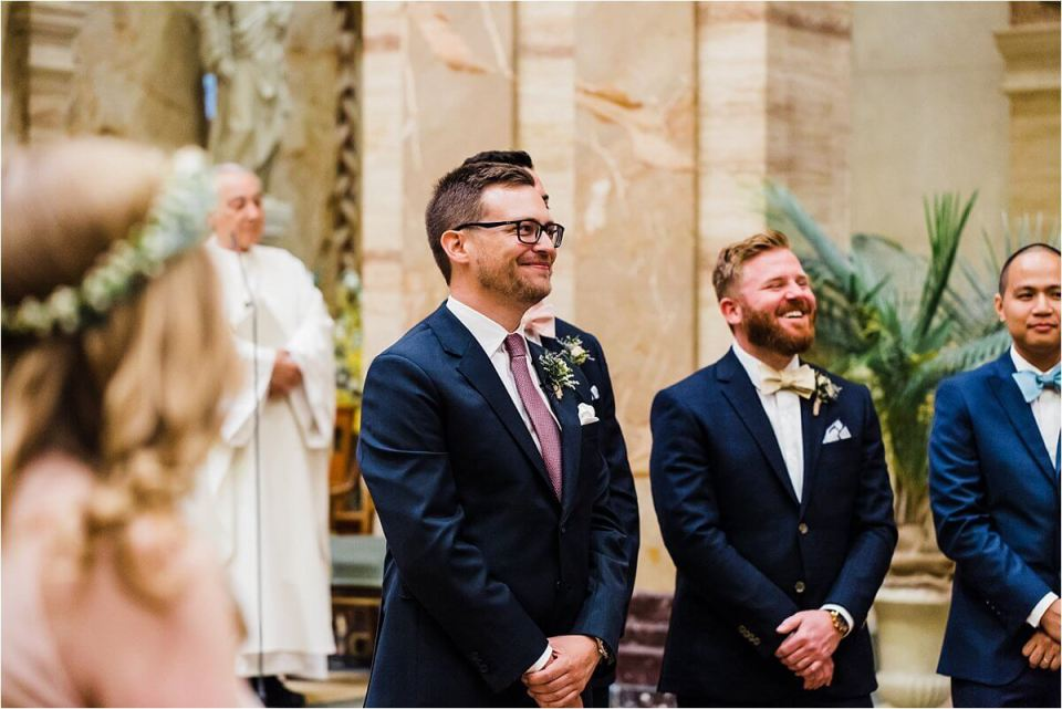 Groom smiling and waiting for his bride to come down the aisle - Dylan and Sandra of Dyan Martin Photography for Weddings and Engagement candid photographer in London, Cambridge, Stratford and Woodstock Ontario